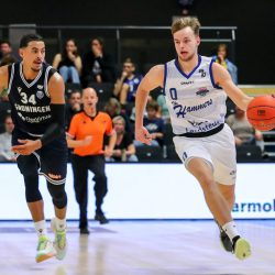 ZWOLLE, NETHERLANDS - SEPTEMBER 19: Marquis Addison of Donar, Bart van Schaik of Landstede Hammers Zwolle during the Pre-Season match between Landstede Hammers and Donar at Landstede Sportcentrum on September 19, 2021 in Zwolle, Netherlands (Photo by Albert ten Hove/Orange Pictures)